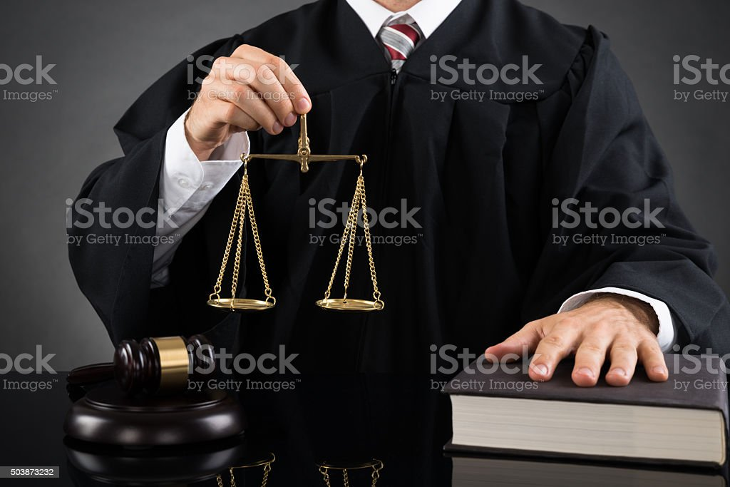 Judge Holding Weight Scale stock photo
