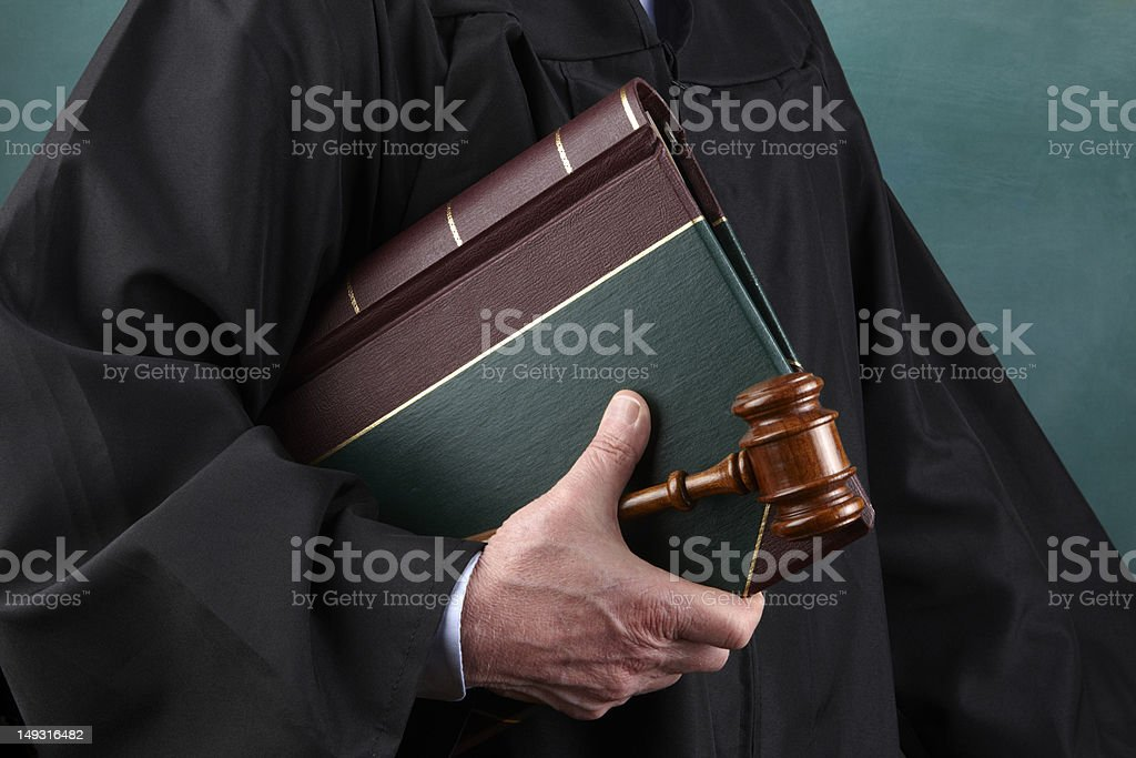 Judge, law book and gavel stock photo