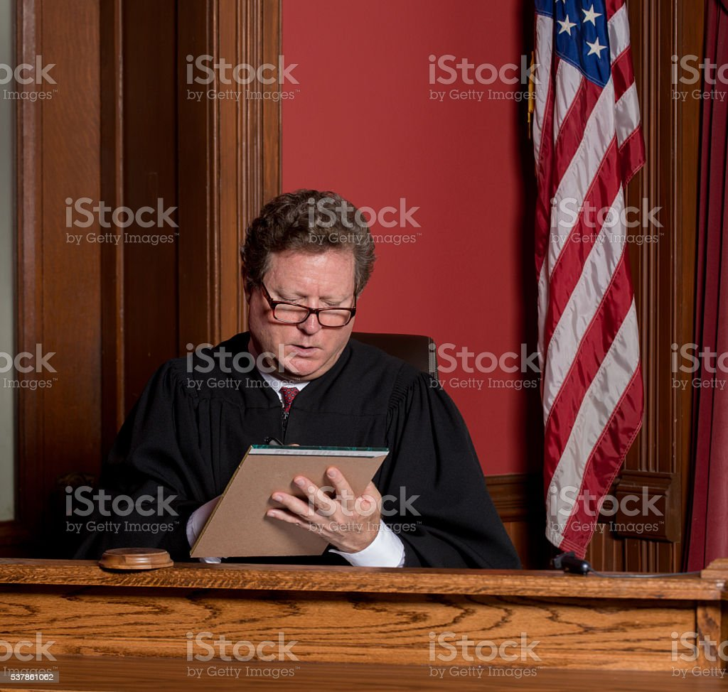 Judge Making Notes stock photo
