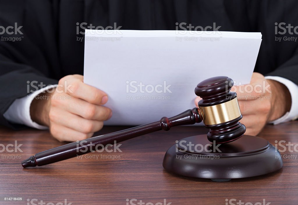 Judge Reading Documents At Desk stock photo
