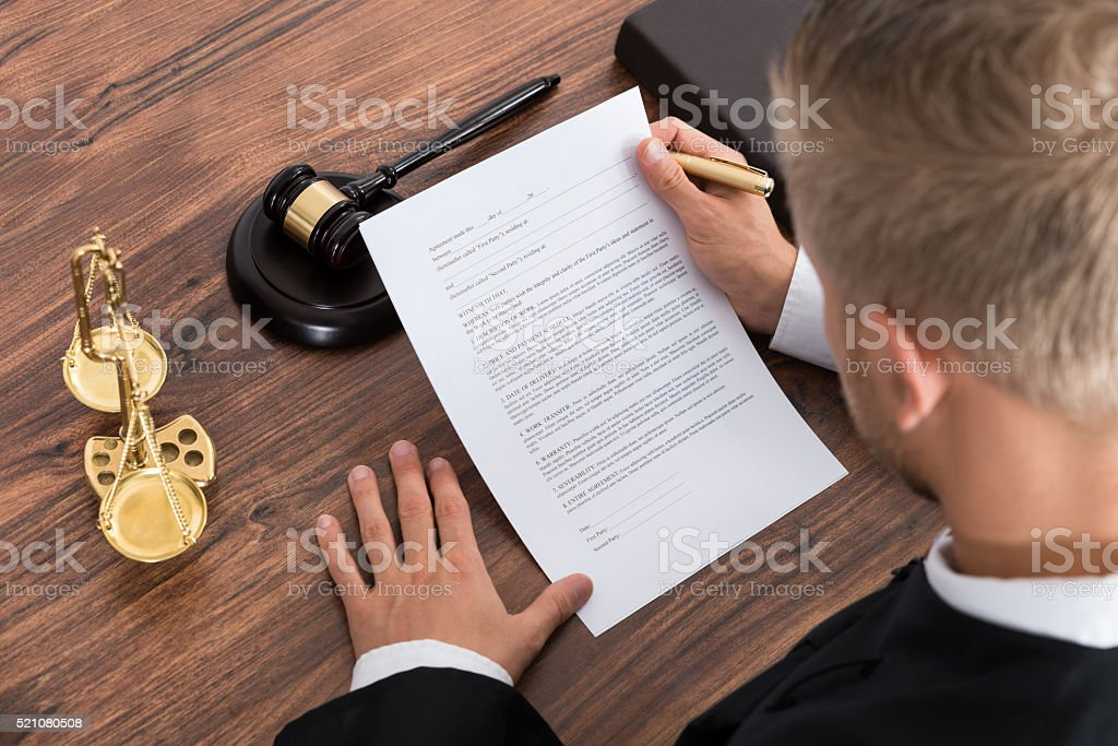 Judge Reading Paper In Courtroom stock photo