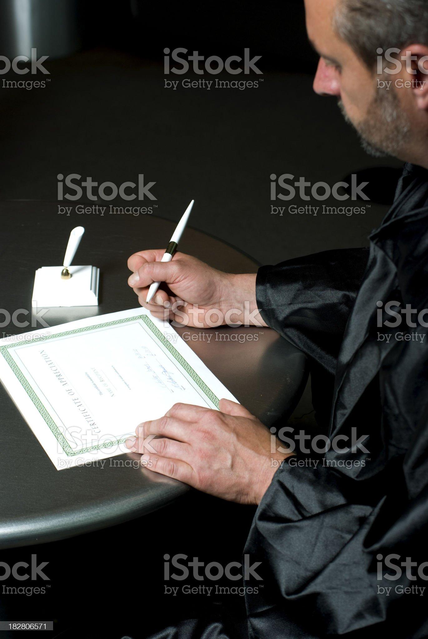 Judge siging document royalty-free stock photo