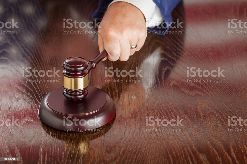 Judge Slams Gavel and American Flag Table Reflection stock photo