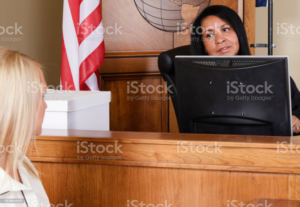 Judge Talking to the Court Clerk royalty-free stock photo