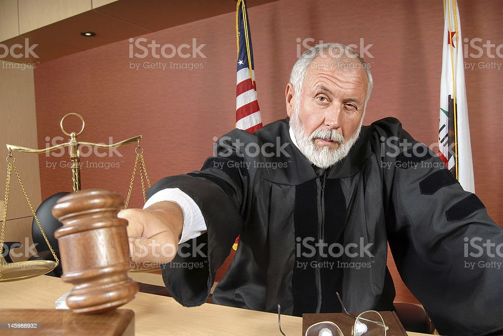 Judge using his gavel stock photo