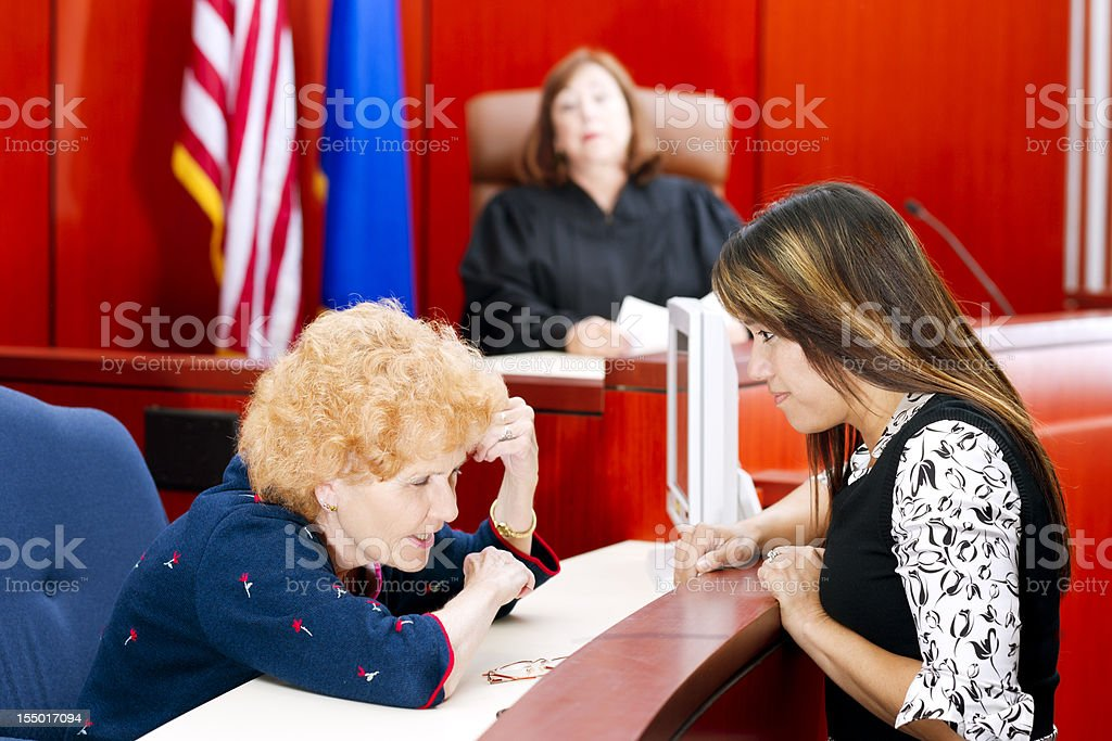 Judge watches as attorney questions the witness royalty-free stock photo