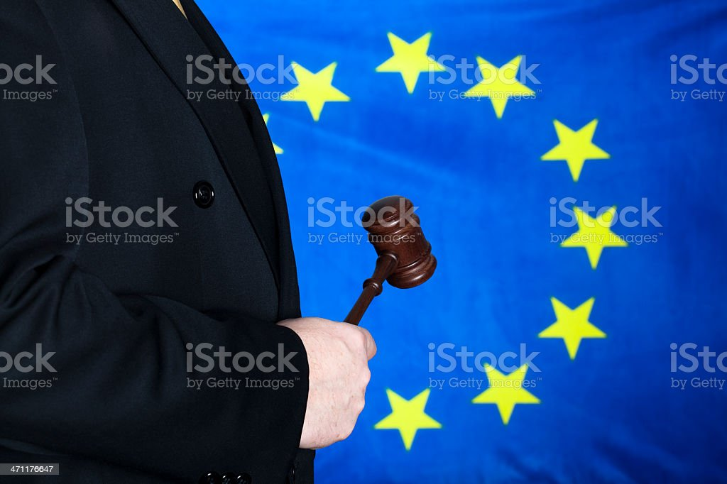 Judge with gavel against EU flag royalty-free stock photo