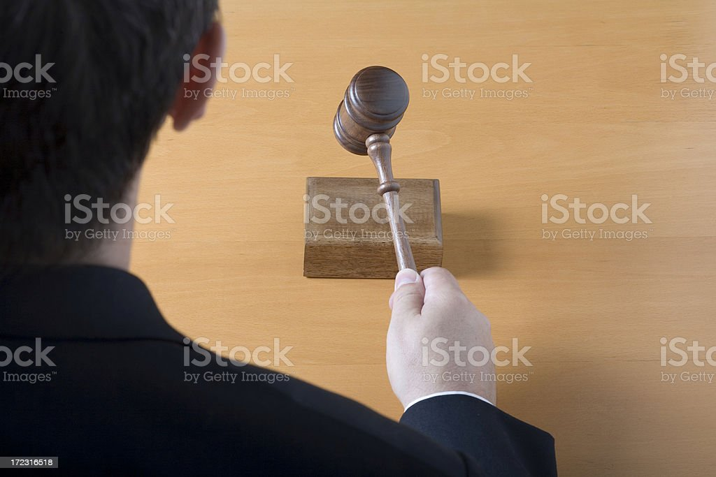 Judge with gavel from behind royalty-free stock photo