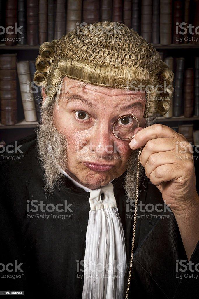 Judge with monocle stock photo
