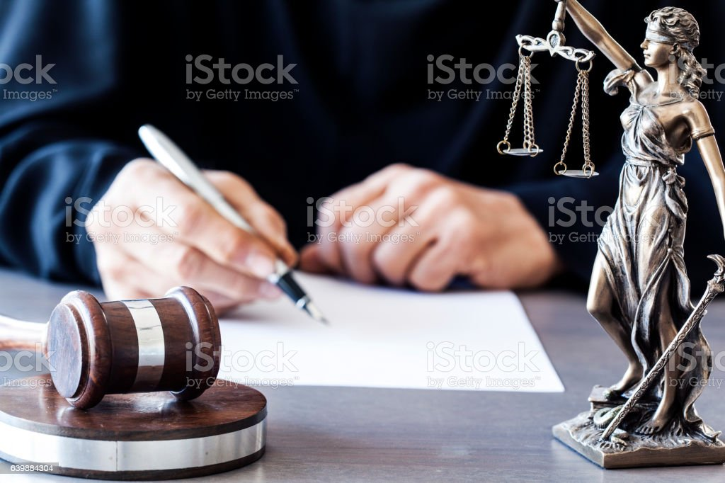 Judge with wooden gavel on table stock photo