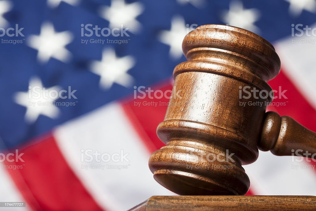 Judge's gavel against US flag royalty-free stock photo