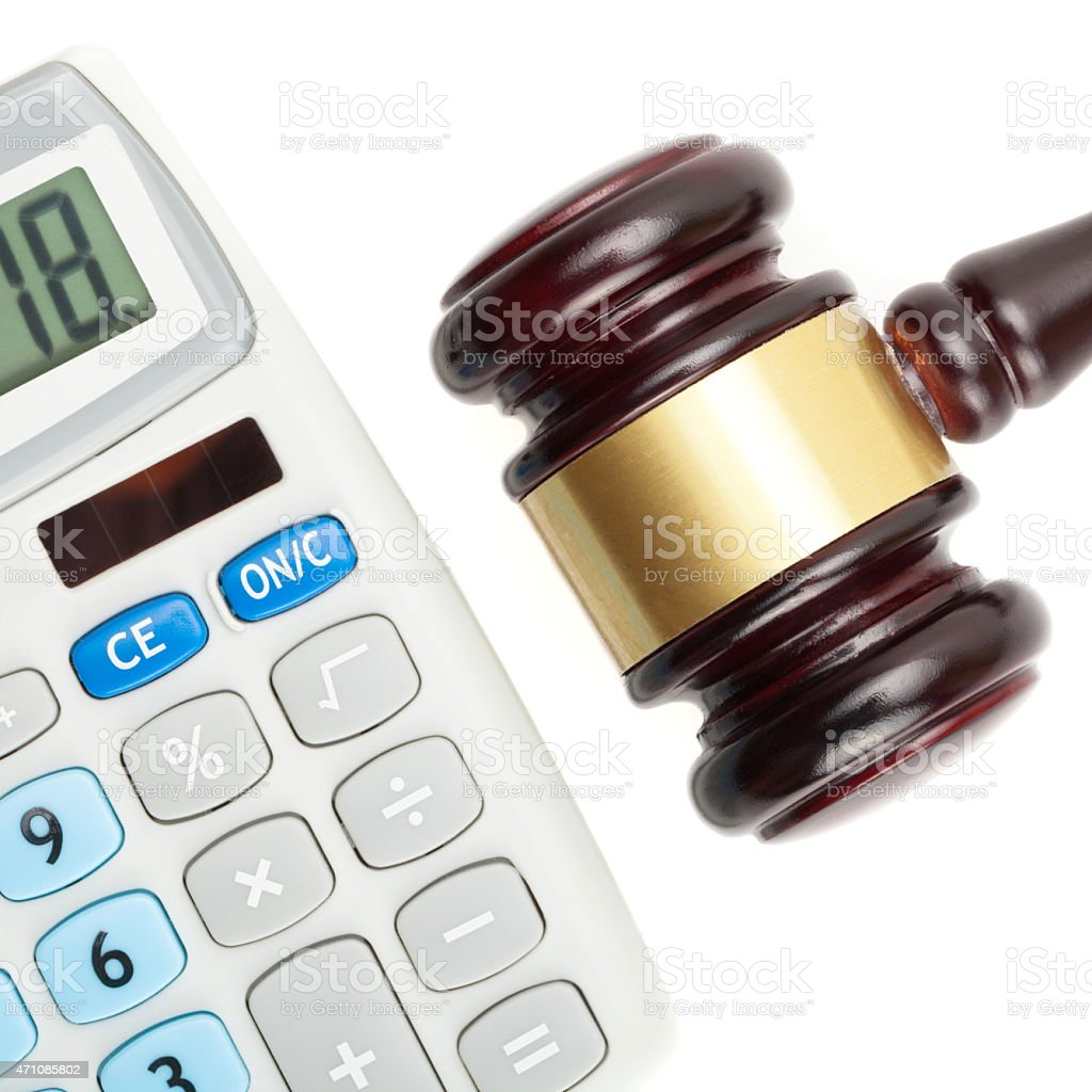 Judge's gavel and calculator - close up shot over white stock photo
