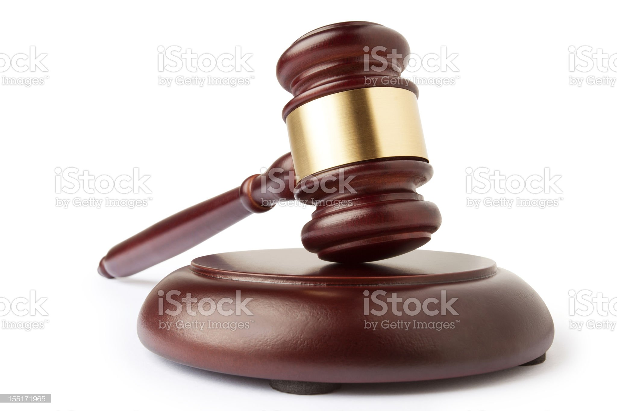 A judge's gavel and sound block set in wood royalty-free stock photo