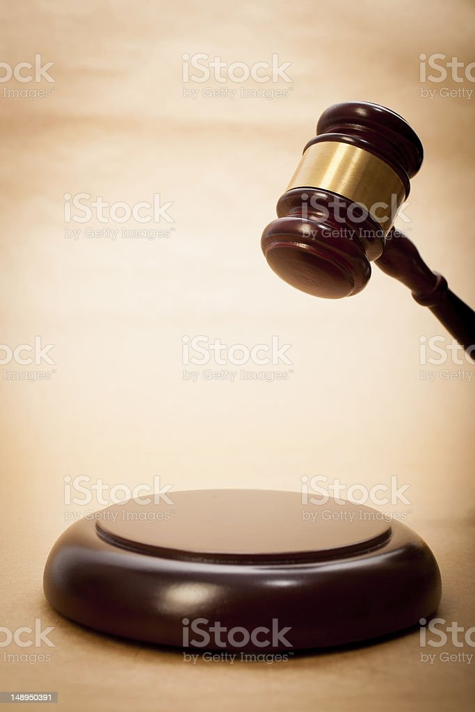 A judge's gavel and soundboard royalty-free stock photo