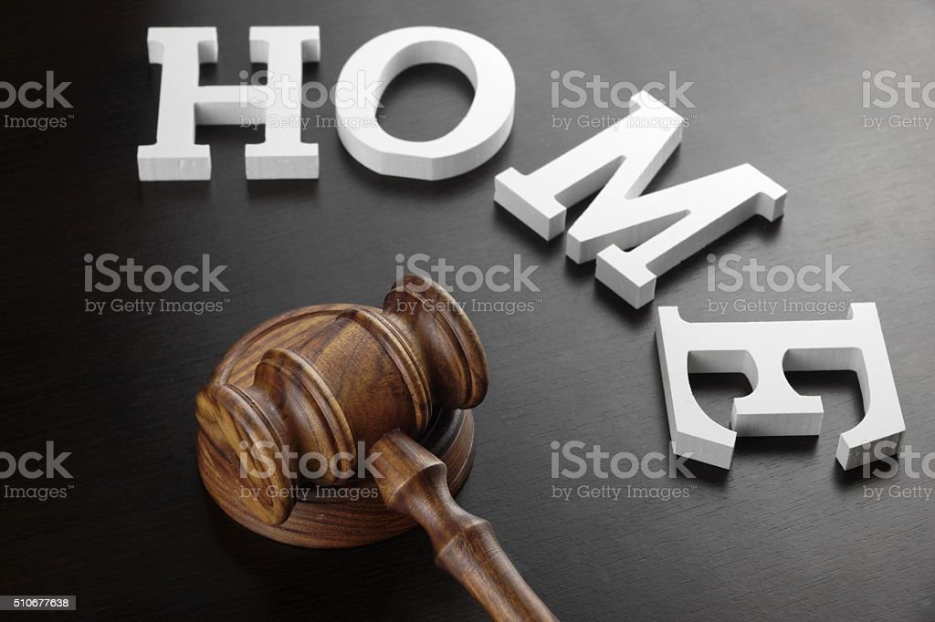 Judges Gavel And White Sign Home On Black Wood  Background. stock photo