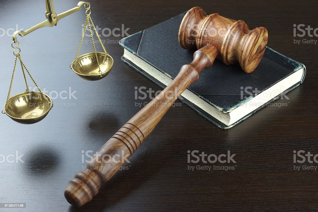 Judges Gavel, Old Book, Scale Of Justice On Black Table stock photo