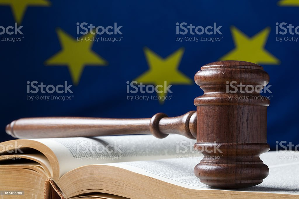 Judges gavel on book with flag in back stock photo