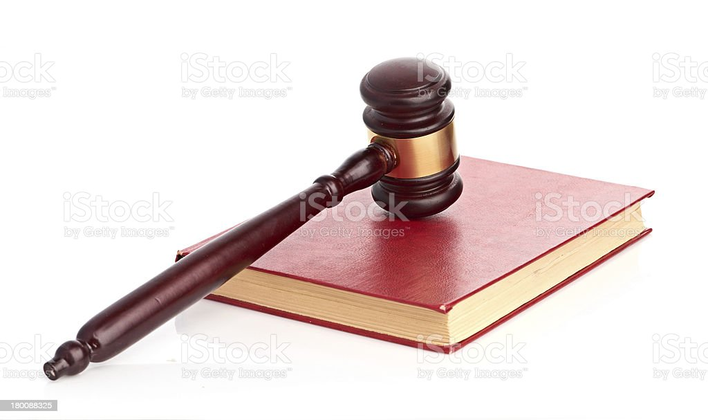 Judge's gavel on red legal book royalty-free stock photo