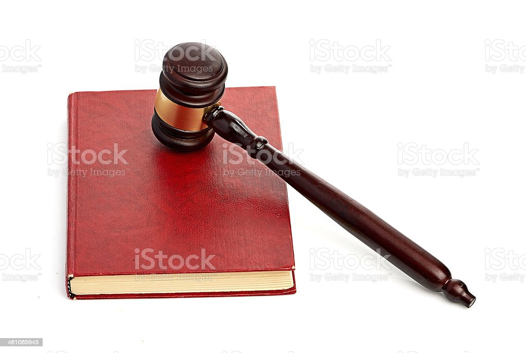 Judge's gavel on red legal book stock photo