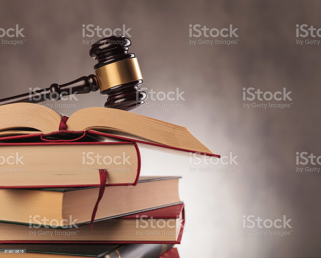 judge's gavel on top  of books with copyspace stock photo