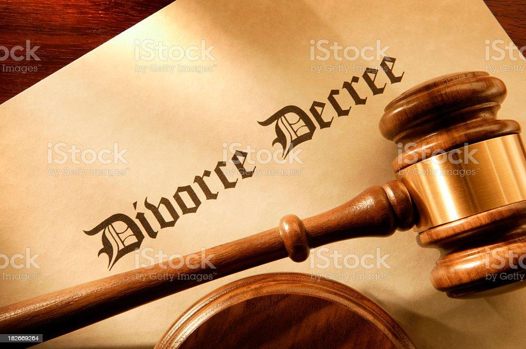 Judge's gavel resting on a divorce decree stock photo