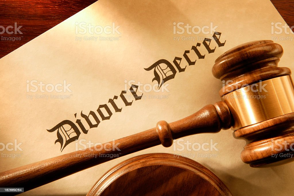 Judge's gavel resting on a divorce decree stock photo