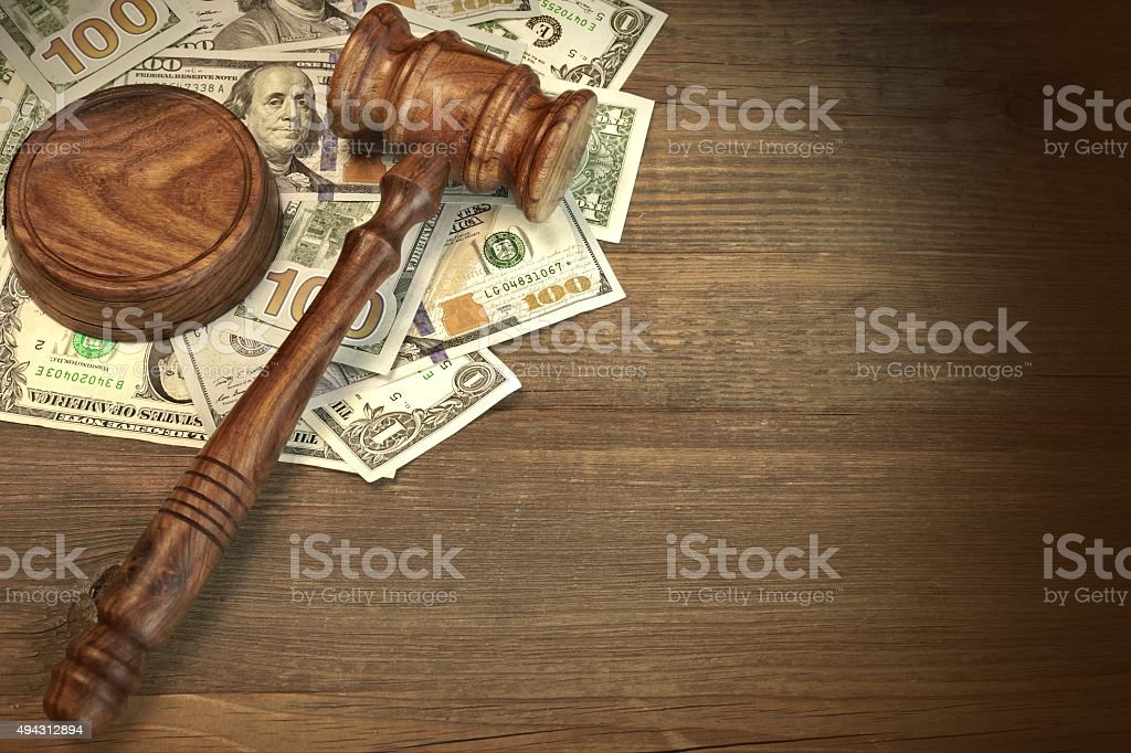 Judges or Auctioneer Gavel And Money On The Wooden Table stock photo