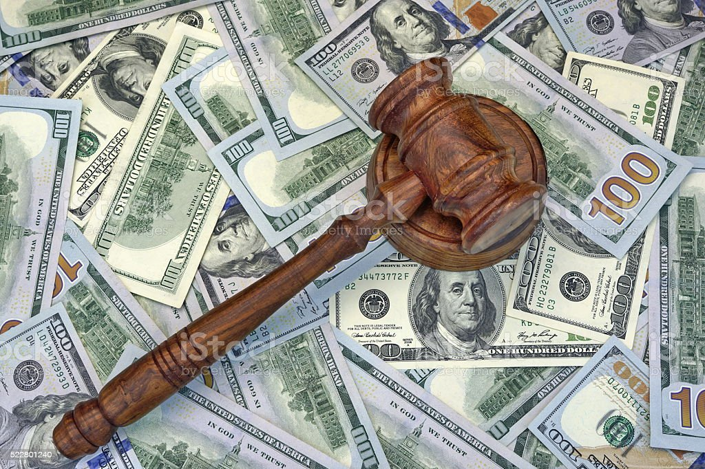 Judges Or Auctioneer Gavel On The Dollar Cash Background stock photo