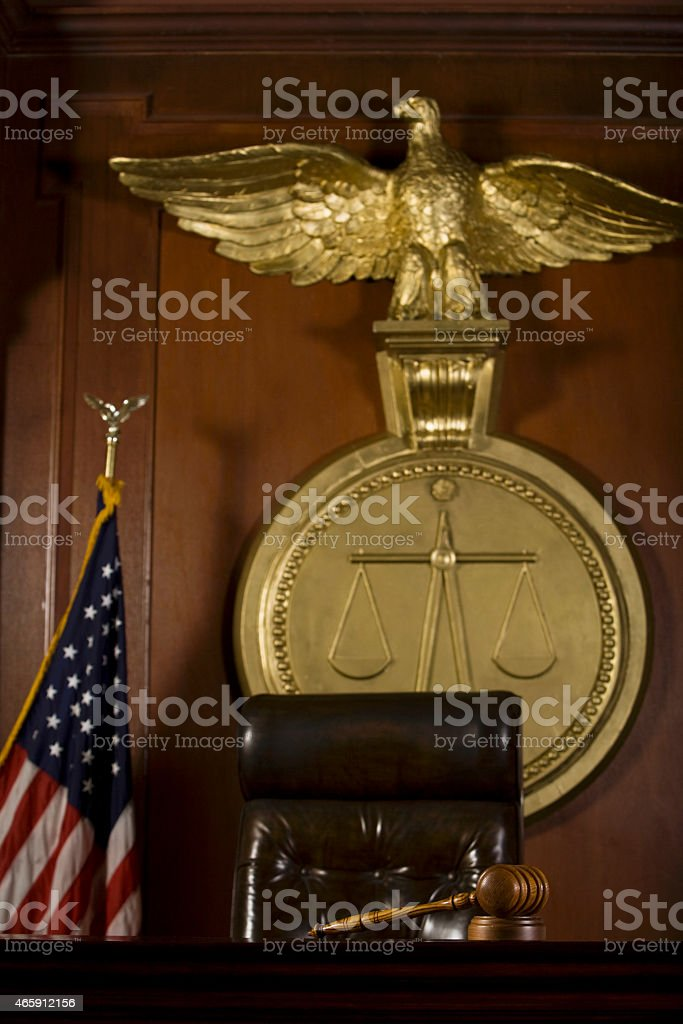 Judge's Seat; Bird; Gavel And American Flag In Court stock photo
