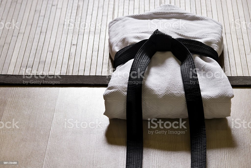 judo dress with black belt stock photo