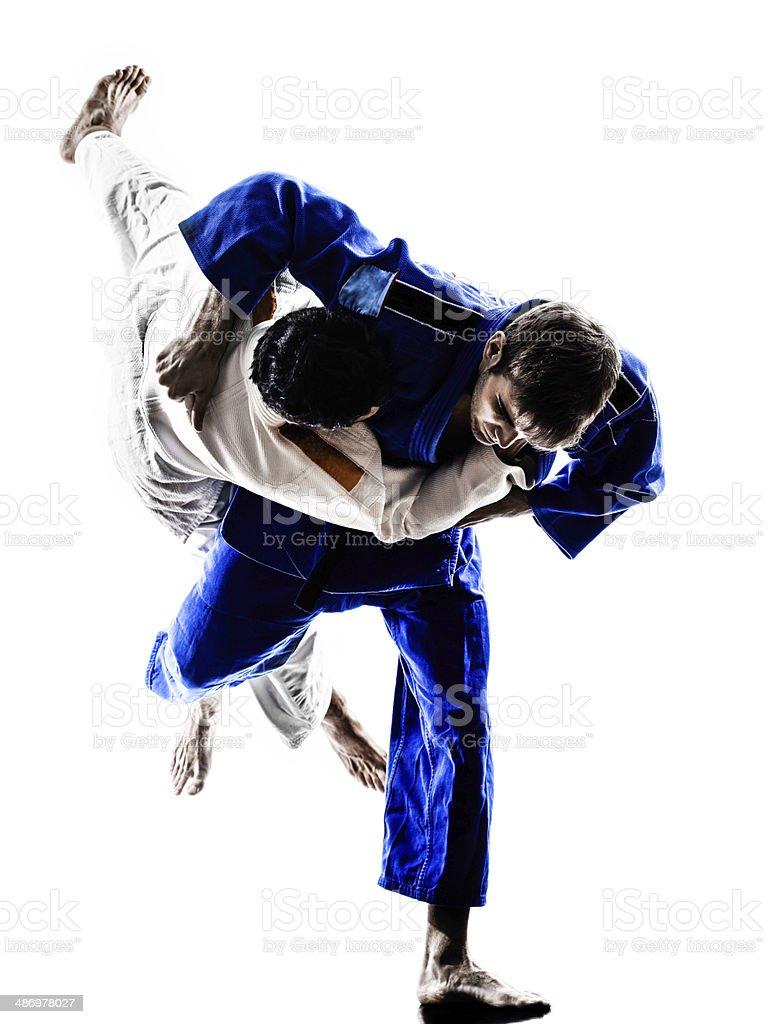 judokas fighters fighting men silhouettes stock photo