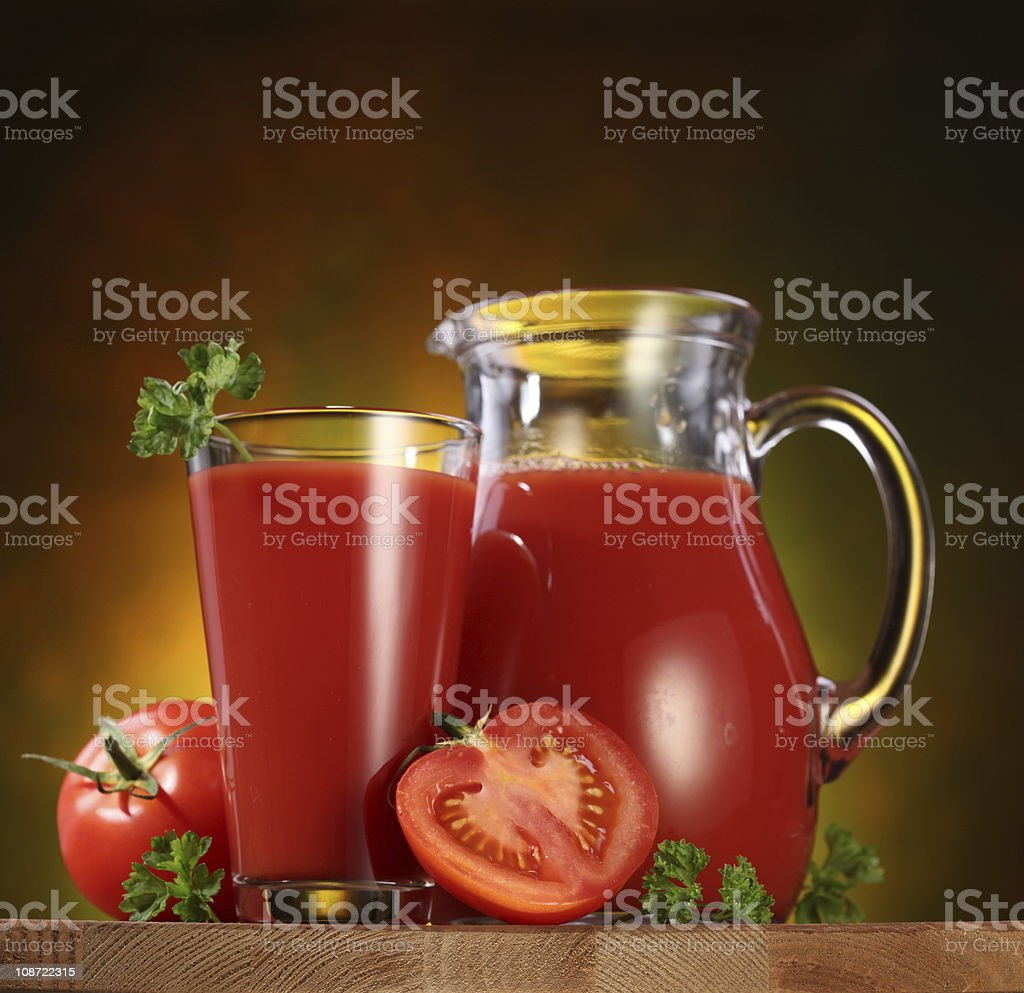 Jug and glass full of tomato juice. royalty-free stock photo
