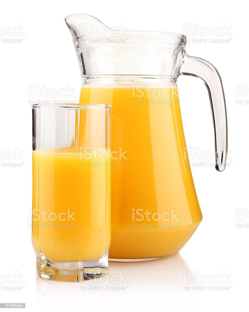 Jug and glass of orange juice isolated on white royalty-free stock photo