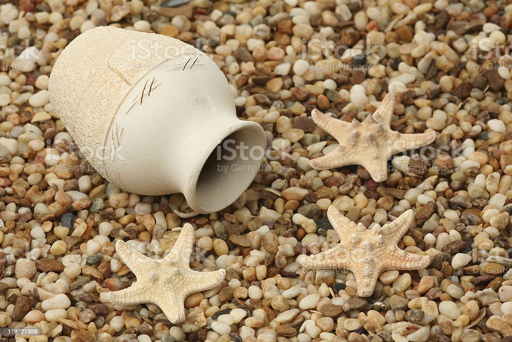 Jug and starfishes royalty-free stock photo