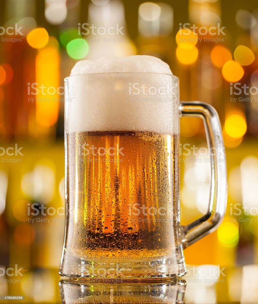 Jug of beer served on bar counter stock photo