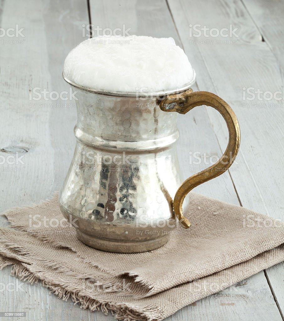 Jug of butttermilk on wooden table stock photo