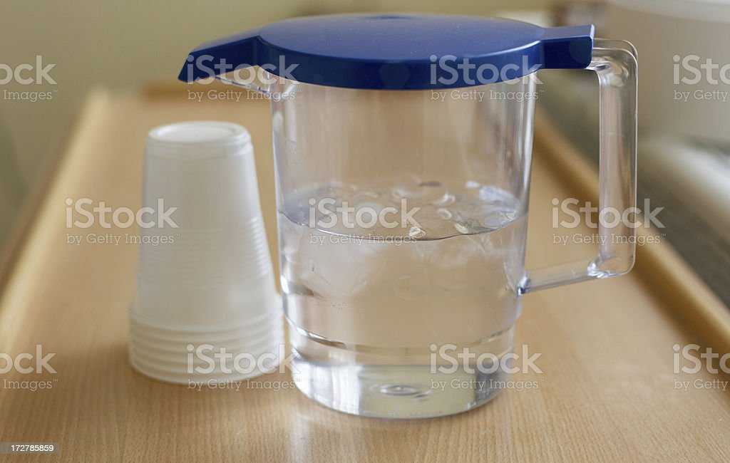 Jug of iced water and cups royalty-free stock photo