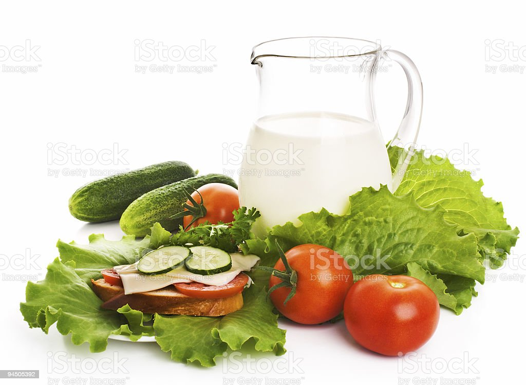 Jug of milk and fresh vegetables royalty-free stock photo