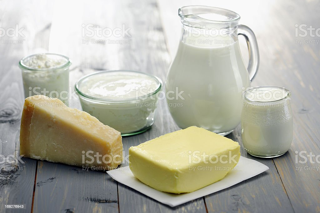 Jug of milk with pat of butter yoghurt and cheese stock photo