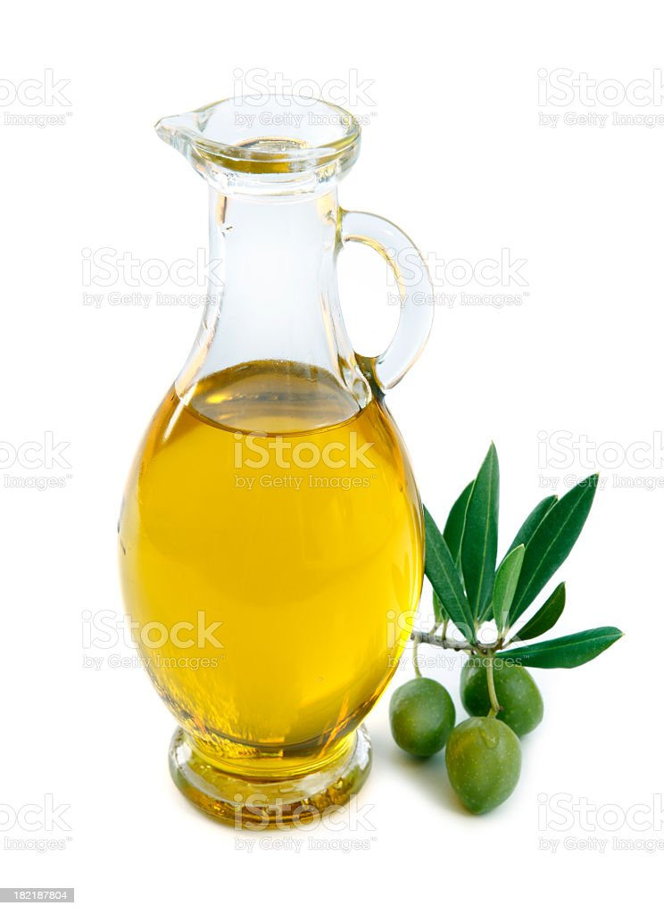 Jug of olive oil with 3 olives by the side stock photo