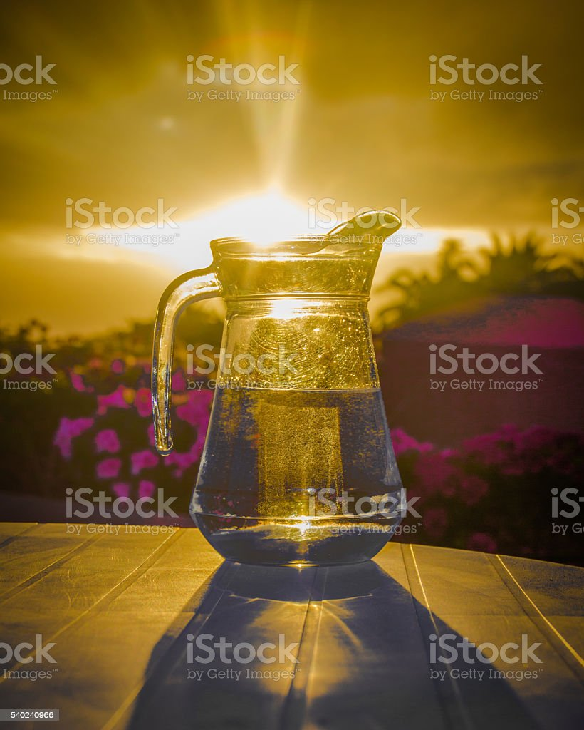 Jug of potable water  and the sunset stock photo