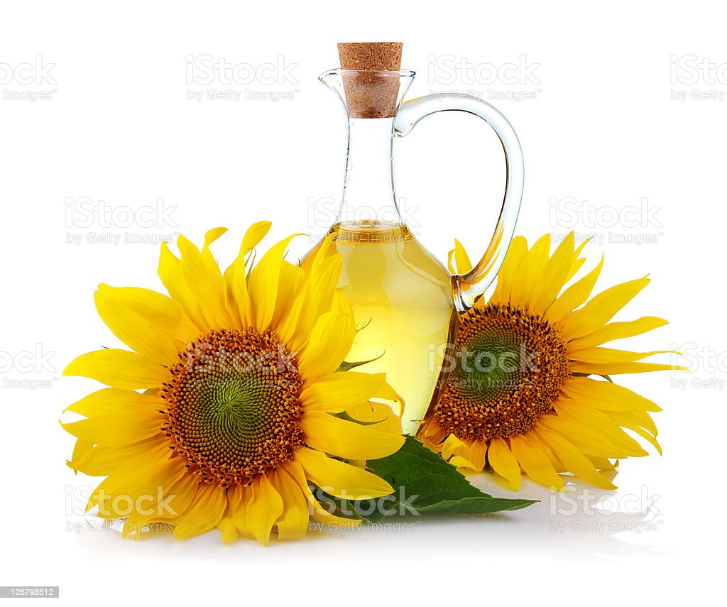 Jug of sunflower oil with flowers isolated royalty-free stock photo
