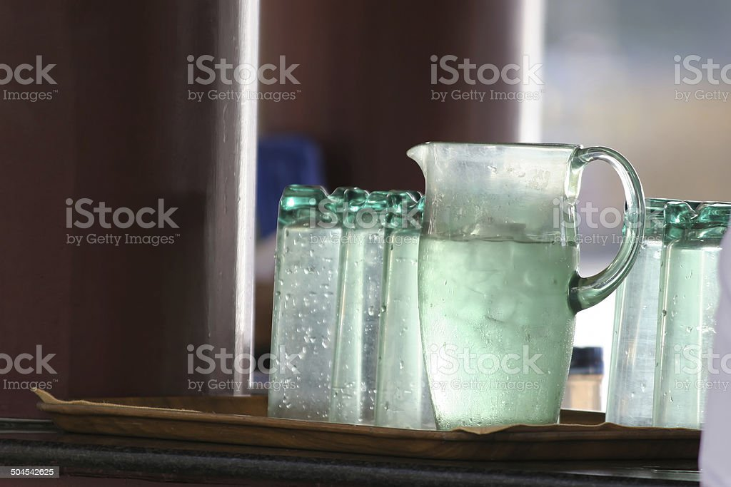 Jug of water with ice cubes royalty-free stock photo