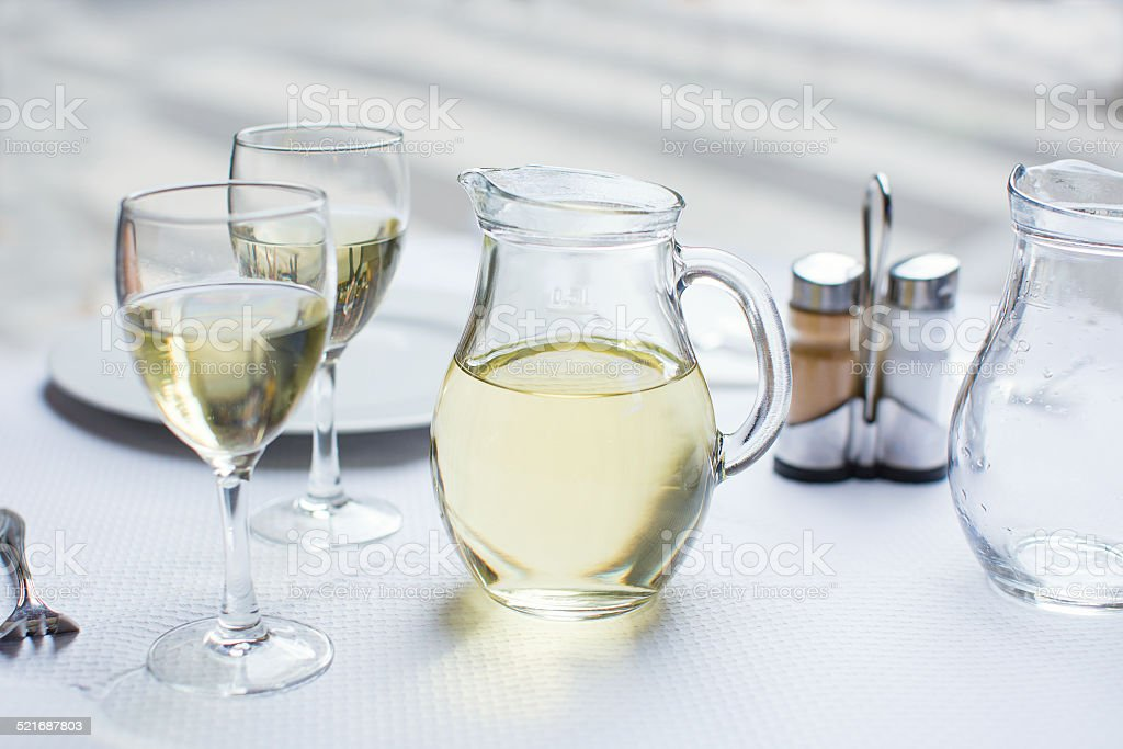 Jug of white wine with two glasses stock photo