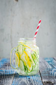Jug with lemon and cucumber infused water