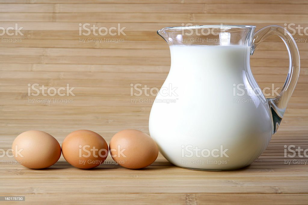 Jug with milk and eggs royalty-free stock photo