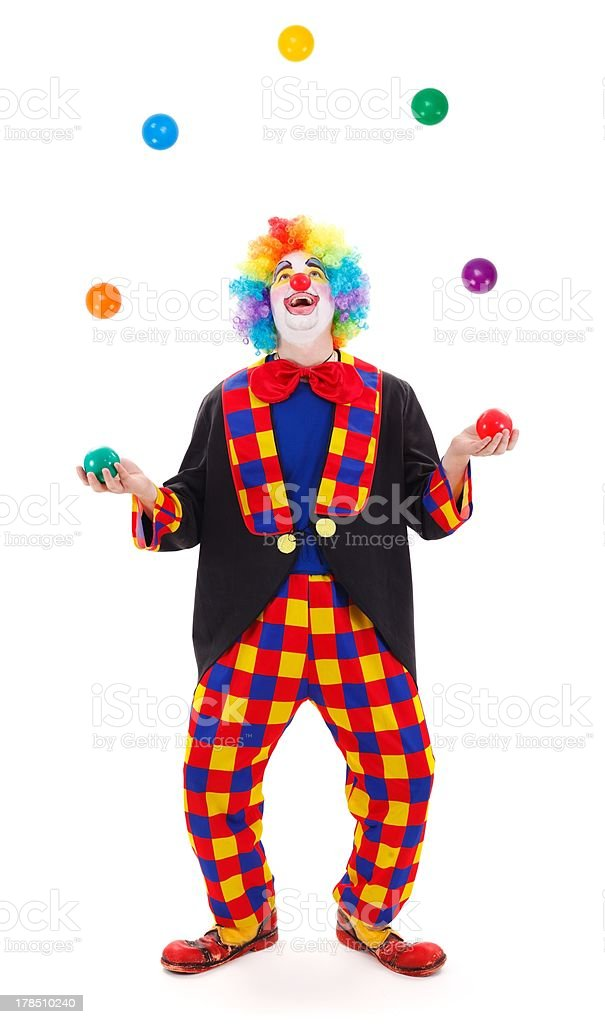 Juggler clown throwing colorful balls stock photo