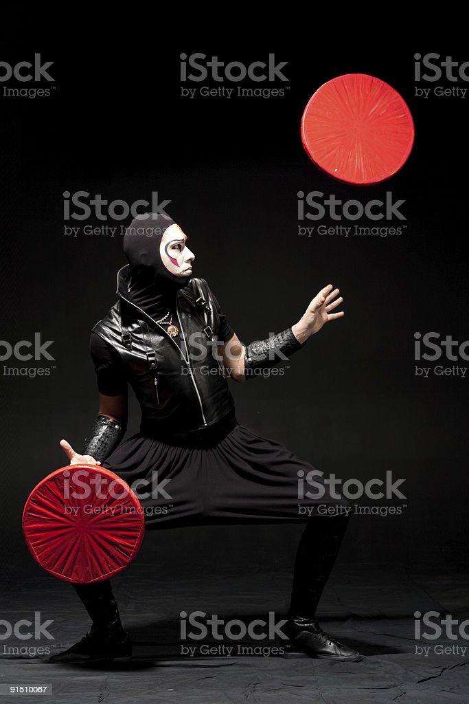 Juggler in black costume. royalty-free stock photo