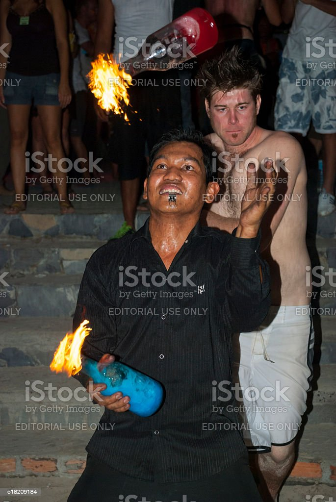 Juggling flaming bottles at Full Moon Party, Ko Phangan, Thailand stock photo