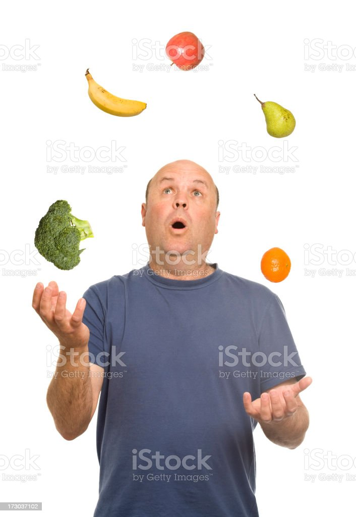Juggling Fruit and Veg stock photo